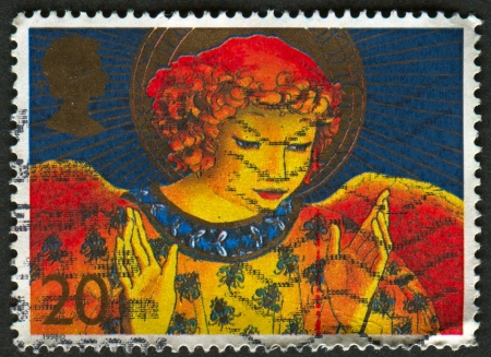 mediaval: UK - CIRCA 1998: A stamp printed in UK shows image of An angel is a supernatural being or spirit, usually humanoid in form, found in various religions and mythologies, circa 1998.