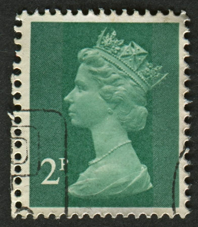 realms: UK-CIRCA 1971:A stamp printed in UK shows image of Elizabeth II is the constitutional monarch of 16 sovereign states known as the Commonwealth realms, in green, circa 1971.