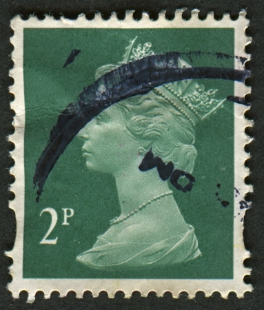 constitutional: UK-CIRCA 1971:A stamp printed in UK shows image of Elizabeth II is the constitutional monarch of 16 sovereign states known as the Commonwealth realms, in green, circa 1971.