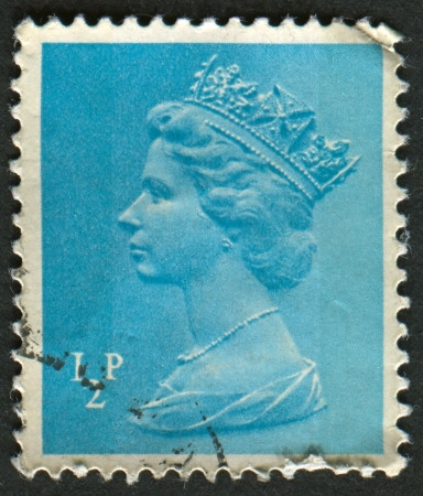 realms: UK-CIRCA 1971:A stamp printed in UK shows image of Elizabeth II is the constitutional monarch of 16 sovereign states known as the Commonwealth realms, in blue, circa 1971.