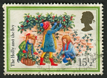 UK - CIRCA 1982: A stamp printed in UK shows image of The Holly and the Ivy, circa 1982.  Stock Photo - 18739861