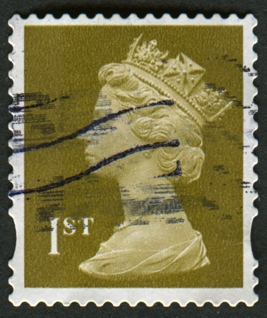 alexandra: UK-CIRCA 2006:A stamp printed in UK shows image of Elizabeth II is the constitutional monarch of 16 sovereign states known as the Commonwealth realms, in gold, circa 2006. Editorial