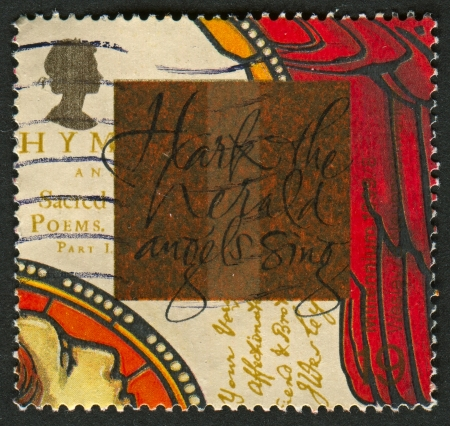 wesley: UK - CIRCA 1999: A stamp printed in UK shows image of The Hark the herald angels sing, and Hymnbook (John Wesley), circa 1999.