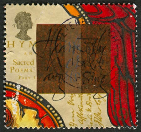 hark: UK - CIRCA 1999: A stamp printed in UK shows image of The Hark the herald angels sing, and Hymnbook (John Wesley), circa 1999.