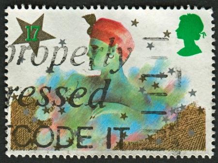 pantomima: Reino Unido - alrededor de 1985: Un sello impreso en Reino Unido muestra la imagen de la Navidad. Personajes Pantomima, alrededor del a�o 1985.