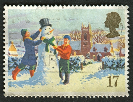 UK - CIRCA 1990: A stamp printed in UK shows image of The Building a Snowman, circa 1990.