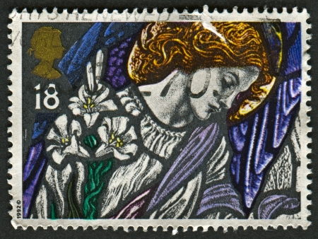 angel gabriel: UK - CIRCA 1992: A stamp printed in UK shows image of The Angel Gabriel, St James, Pangbourne, Stained Glass Windows, circa 1992.