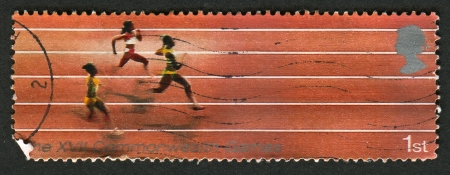 commonwealth: UK - CIRCA 2002: A stamp printed in UK shows image of The Running, 17th Commonwealth Games, Manchester, circa 2002.
