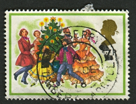 UK - CIRCA 1978: A stamp printed in UK shows image of The Singing Carols round the Christmas Tree, circa 1978.