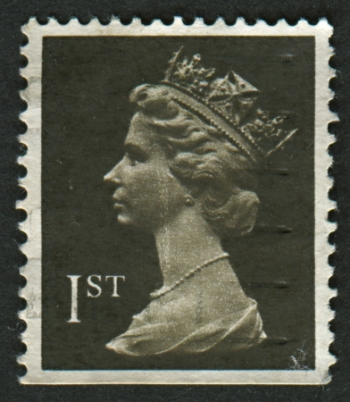 realms: UK-CIRCA 2009:A stamp printed in UK shows image of Elizabeth II is the constitutional monarch of 16 sovereign states known as the Commonwealth realms, in black, circa 2009.