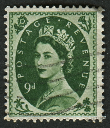 realms: UK-CIRCA 1960:A stamp printed in UK shows image of Elizabeth II is the constitutional monarch of 16 sovereign states known as the Commonwealth realms, in Bronze-Green, circa 1960.