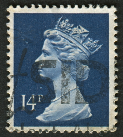 realms: UK-CIRCA 1988:A stamp printed in UK shows image of Elizabeth II is the constitutional monarch of 16 sovereign states known as the Commonwealth realms, in Deep Blue, circa 1988. Editorial