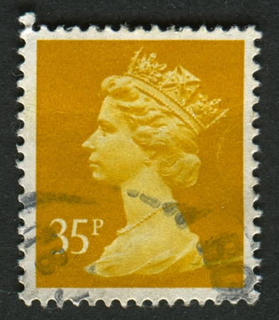 constitutional: UK-CIRCA 1991:A stamp printed in UK shows image of Elizabeth II is the constitutional monarch of 16 sovereign states known as the Commonwealth realms, in yellow, circa 1991.