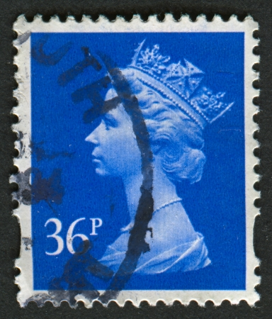 realms: UK-CIRCA 1993:A stamp printed in UK shows image of Elizabeth II is the constitutional monarch of 16 sovereign states known as the Commonwealth realms, in Bright Ultramarine, circa 1993.