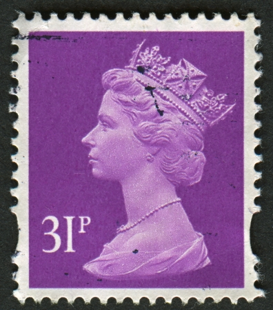 constitutional: UK-CIRCA 1996:A stamp printed in UK shows image of Elizabeth II is the constitutional monarch of 16 sovereign states known as the Commonwealth realms, in purple, circa 1996. Editorial