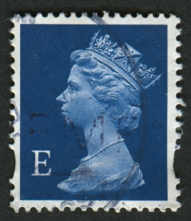 realms: UK-CIRCA 2002:A stamp printed in UK shows image of Elizabeth II is the constitutional monarch of 16 sovereign states known as the Commonwealth realms, in blue, circa 2002.