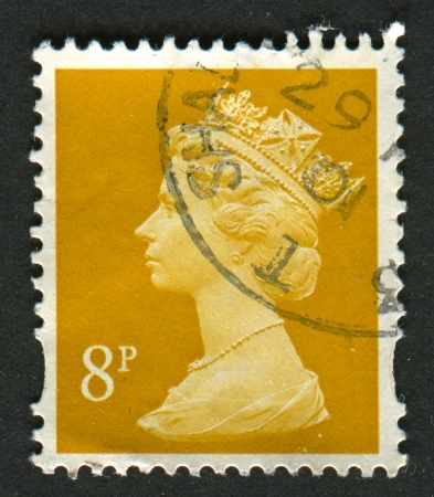 realms: UK-CIRCA 2000:A stamp printed in UK shows image of Elizabeth II is the constitutional monarch of 16 sovereign states known as the Commonwealth realms, in yellow, circa 2000.