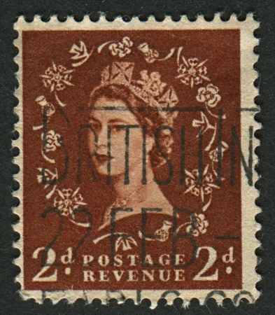 realms: UK-CIRCA 1952:A stamp printed in UK shows image of Elizabeth II is the constitutional monarch of 16 sovereign states known as the Commonwealth realms, in brown, circa 1952.