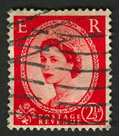 realms: UK-CIRCA 1952:A stamp printed in UK shows image of Elizabeth II is the constitutional monarch of 16 sovereign states known as the Commonwealth realms, in red, circa 1952. Editorial