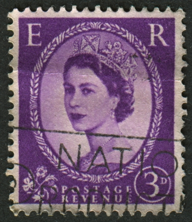 realms: UK-CIRCA 1952:A stamp printed in UK shows image of Elizabeth II is the constitutional monarch of 16 sovereign states known as the Commonwealth realms, in purple, circa 1952.