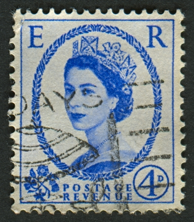 realms: UK-CIRCA 1952:A stamp printed in UK shows image of Elizabeth II is the constitutional monarch of 16 sovereign states known as the Commonwealth realms, in blue, circa 1952. Editorial