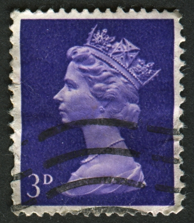 constitutional: UK-CIRCA 1967:A stamp printed in UK shows image of Elizabeth II is the constitutional monarch of 16 sovereign states known as the Commonwealth realms, in violet, circa 1967.