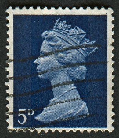 realms: UK-CIRCA 1968:A stamp printed in UK shows image of Elizabeth II is the constitutional monarch of 16 sovereign states known as the Commonwealth realms, in blue, circa 1968.