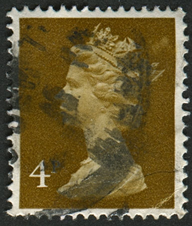 realms: UK-CIRCA 1971:A stamp printed in UK shows image of Elizabeth II is the constitutional monarch of 16 sovereign states known as the Commonwealth realms, in brown, circa 1971.