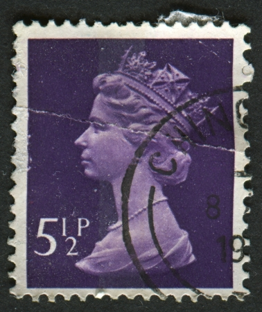 realms: UK-CIRCA 1973:A stamp printed in UK shows image of Elizabeth II is the constitutional monarch of 16 sovereign states known as the Commonwealth realms, in Violet, circa 1973.