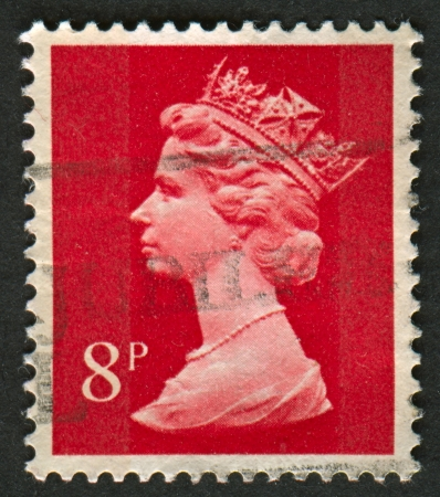 realms: UK-CIRCA 1973:A stamp printed in UK shows image of Elizabeth II is the constitutional monarch of 16 sovereign states known as the Commonwealth realms, in red, circa 1973.