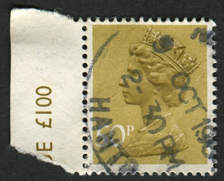 realms: UK-CIRCA 1977:A stamp printed in UK shows image of Elizabeth II is the constitutional monarch of 16 sovereign states known as the Commonwealth realms, in yellow, circa 1977. Editorial