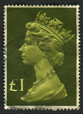 realms: UK-CIRCA 1977:A stamp printed in UK shows image of Elizabeth II is the constitutional monarch of 16 sovereign states known as the Commonwealth realms, in green, circa 1977.