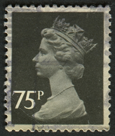 constitutional: UK-CIRCA 1980:A stamp printed in UK shows image of Elizabeth II is the constitutional monarch of 16 sovereign states known as the Commonwealth realms, in Charcoal, circa 1980.