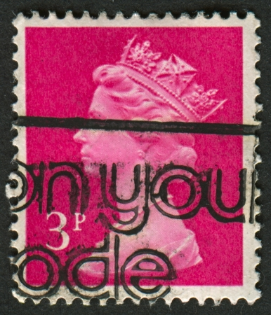 constitutional: UK-CIRCA 1980:A stamp printed in UK shows image of Elizabeth II is the constitutional monarch of 16 sovereign states known as the Commonwealth realms, in Bright Magenta, circa 1980.