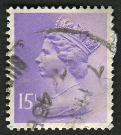 UK-CIRCA 1981:A stamp printed in UK shows image of Elizabeth II is the constitutional monarch of 16 sovereign states known as the Commonwealth realms, in Pale Violet, circa 1981.