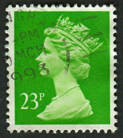 realms: UK-CIRCA 1988:A stamp printed in UK shows image of Elizabeth II is the constitutional monarch of 16 sovereign states known as the Commonwealth realms, in Bright Green, circa 1988.