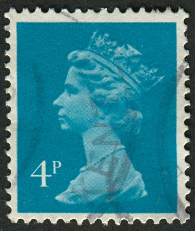 realms: UK-CIRCA 1993:A stamp printed in UK shows image of Elizabeth II is the constitutional monarch of 16 sovereign states known as the Commonwealth realms, in new blue, circa 1993.