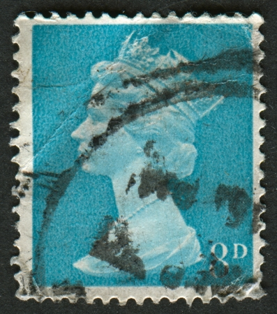 UK-CIRCA 1968:A stamp printed in UK shows image of Elizabeth II is the constitutional monarch of 16 sovereign states known as the Commonwealth realms, in Vermillion, circa 1968. Editorial