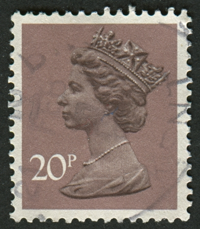 realms: UK-CIRCA 1976:A stamp printed in UK shows image of Elizabeth II is the constitutional monarch of 16 sovereign states known as the Commonwealth realms, in Dull Purple, circa 1976.