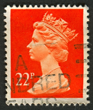 constitutional: UK-CIRCA 1990:A stamp printed in UK shows image of Elizabeth II is the constitutional monarch of 16 sovereign states known as the Commonwealth realms, in red, circa 1990.