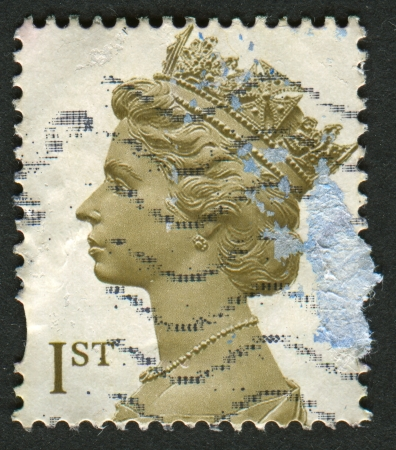 realms: UK-CIRCA 2000:A stamp printed in UK shows image of Elizabeth II is the constitutional monarch of 16 sovereign states known as the Commonwealth realms, in Olive-Brown , circa 2000.