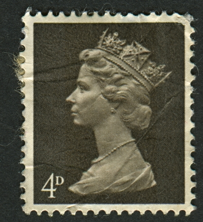 constitutional: UK-CIRCA 1967:A stamp printed in UK shows image of Elizabeth II is the constitutional monarch of 16 sovereign states known as the Commonwealth realms, in Sepia, circa 1967. Editorial