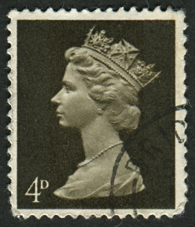 realms: UK-CIRCA 1967:A stamp printed in UK shows image of Elizabeth II is the constitutional monarch of 16 sovereign states known as the Commonwealth realms, in Sepia, circa 1967. Editorial
