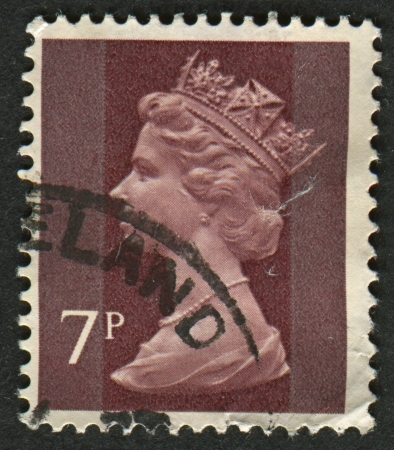 realms: UK-CIRCA 1975:A stamp printed in UK shows image of Elizabeth II is the constitutional monarch of 16 sovereign states known as the Commonwealth realms, in Purple Brown , circa 1975.