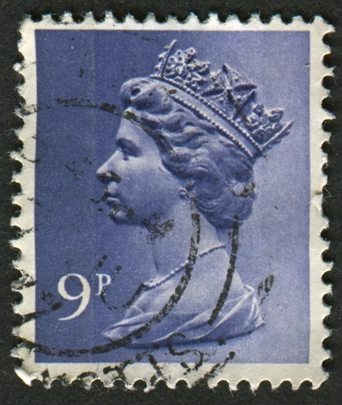 realms: UK-CIRCA 1976:A stamp printed in UK shows image of Elizabeth II is the constitutional monarch of 16 sovereign states known as the Commonwealth realms, in Deep Violet , circa 1976.