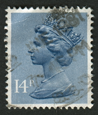 realms: UK-CIRCA 1981:A stamp printed in UK shows image of Elizabeth II is the constitutional monarch of 16 sovereign states known as the Commonwealth realms, in Grey Blue, circa 1981.