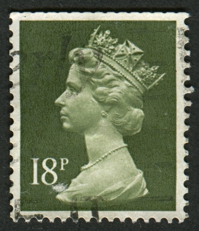 constitutional: UK-CIRCA 1984:A stamp printed in UK shows image of Elizabeth II is the constitutional monarch of 16 sovereign states known as the Commonwealth realms, in Deep Olive Grey, circa 1984.