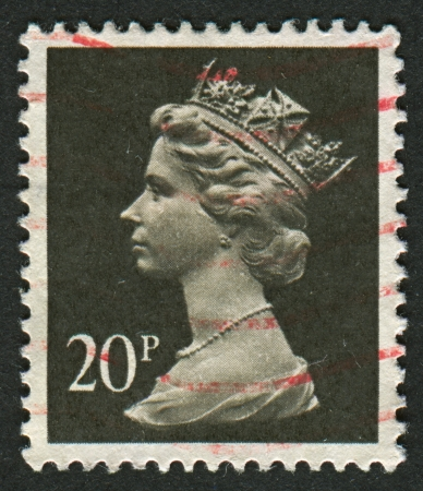 UK-CIRCA 1990:A stamp printed in UK shows image of Elizabeth II is the constitutional monarch of 16 sovereign states known as the Commonwealth realms, in Brownish Black and Cream, circa 1990.