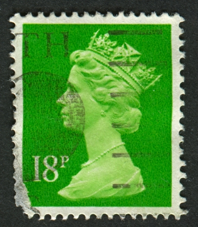 realms: UK-CIRCA 1991:A stamp printed in UK shows image of Elizabeth II is the constitutional monarch of 16 sovereign states known as the Commonwealth realms, in Bright Green, circa 1991.