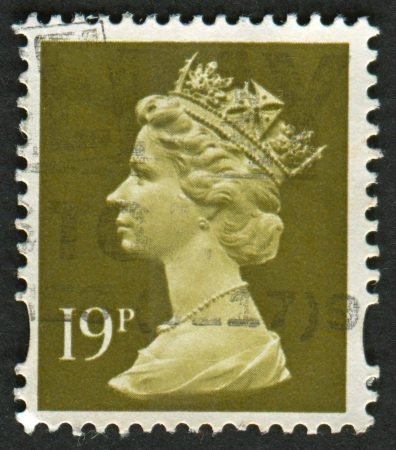 constitutional: UK-CIRCA 1993:A stamp printed in UK shows image of Elizabeth II is the constitutional monarch of 16 sovereign states known as the Commonwealth realms, in Bistre, circa 1993.
